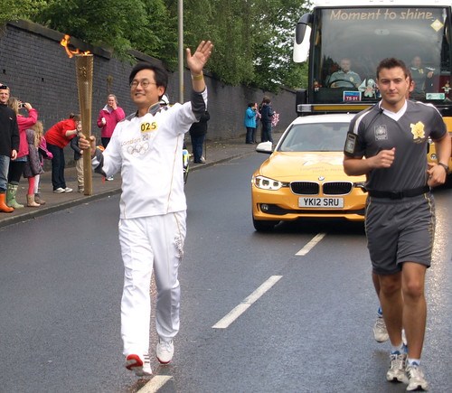 The Olympic Torch in Preston - jogging down Tulketh Brow | by Tony Worrall