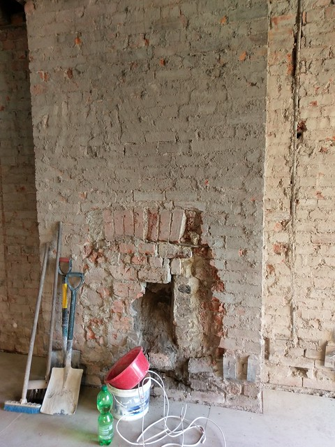 Wall covering have been removed - discovered a bricked in fireplace.  We're not using it as it just won't work with the rest of the room.  Plus it'd be darn expensive to fix it up.