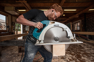 "Tyler Cutting a Timber w/ 16"" Saw 