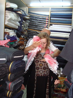 Here, the store owner wrapped Samantha in the first of many outfits. | by NU Journalism in Amman