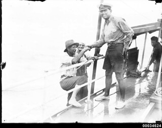 Civilians climbing aboard a vessel with an officer lending a hand, 1890-1953 | by Australian National Maritime Museum on The Commons