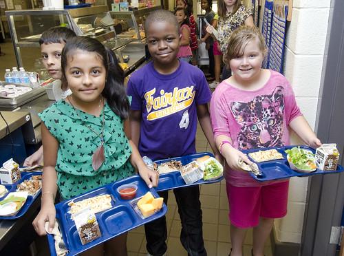 Children with their school meals