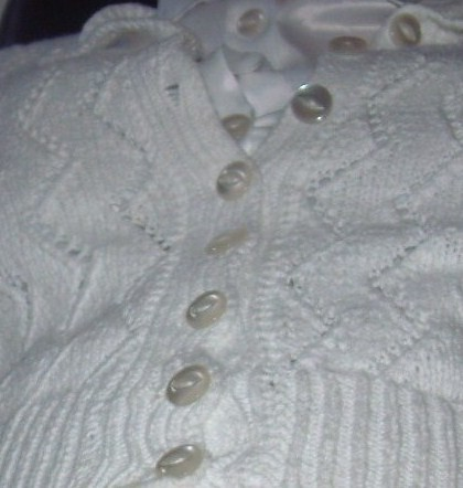 Shiney white fisheye buttons. Many pleasurable moments had while wearing this cardigan. | by linda buttons