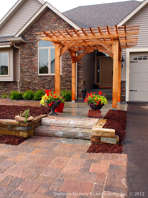 Custom Crafted Front Entrance Cedar Arbor With Borgert Strassen 174 Bavaria Tumbled Paver Patio