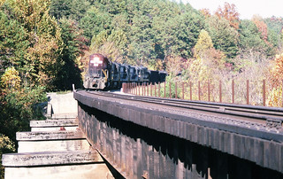 Norfolk Southern unit coal train with an ex N&W locomotive leading four more locomotives is perparing to cross a steel deck bridge in Tennessee, October 1987 | by alcomike43
