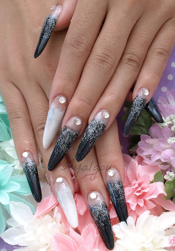 Long nails in black and white with silver accents | by aya1gou
