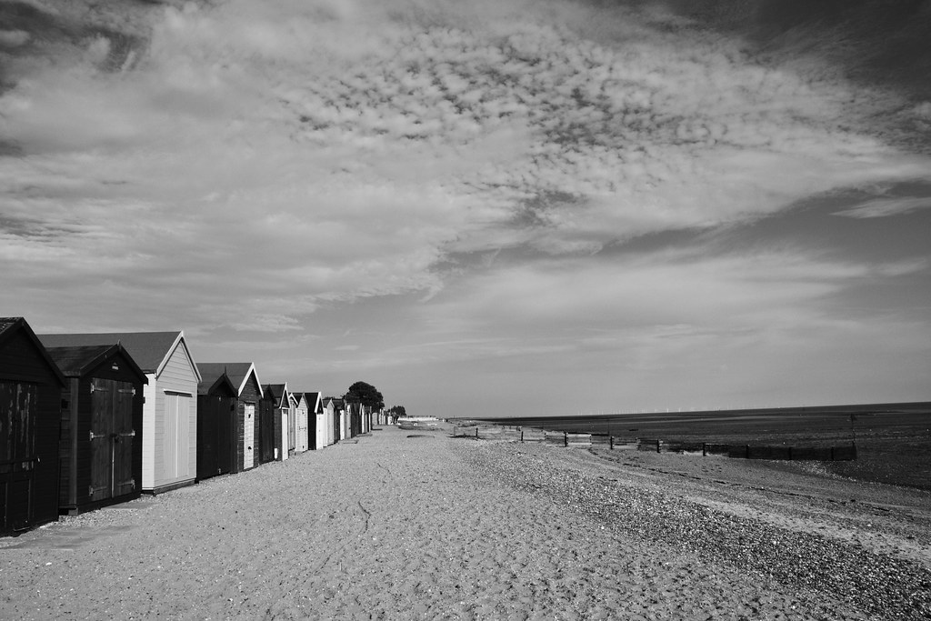 West Mersea, Beach Huts and Clouds. | Black and white ...