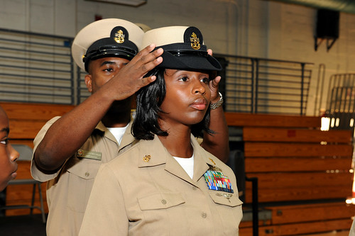 A new chief receives her combination cover. | by Official U.S. Navy Imagery