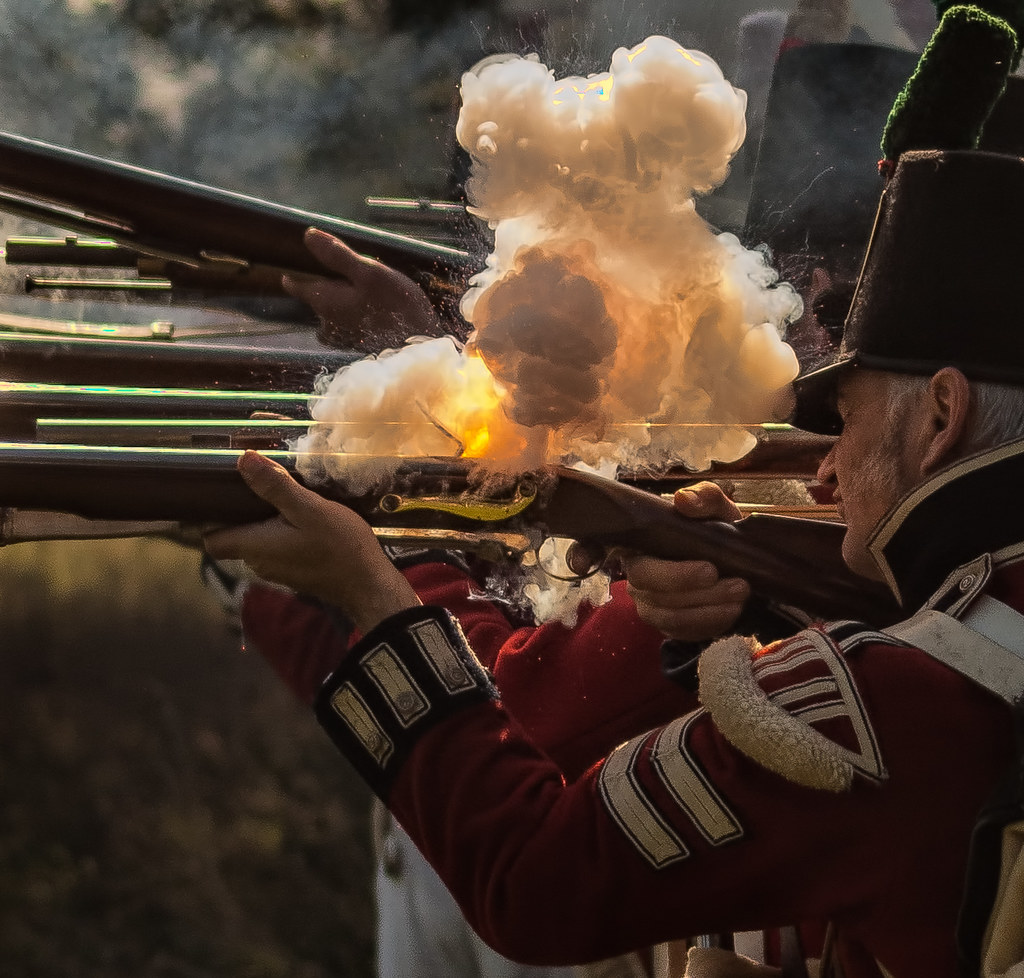 Black Powder Ignites In The Firing Pan Of A Flintlock Musk