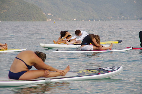 Yoga on a stand up paddle board | by widiwici