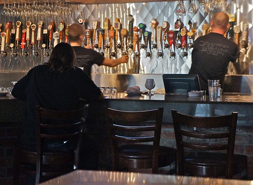 It Takes Two Bartenders Working Feverishly to Keep this Lady's Glasses Full of Beer | by ricko