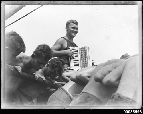 Playing an accordian while the crew turn a windlass onboard MAGDALENE VINNEN | by Australian National Maritime Museum on The Commons