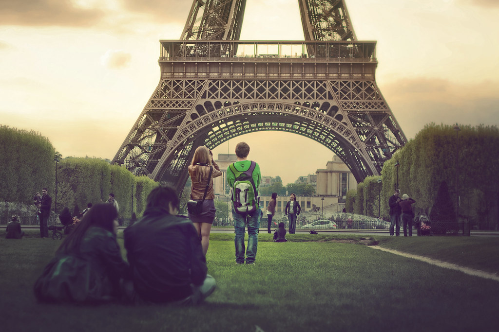 Couple clicking pictures at Eiffel Tower, Paris