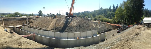 Crews placing the culvert in sections