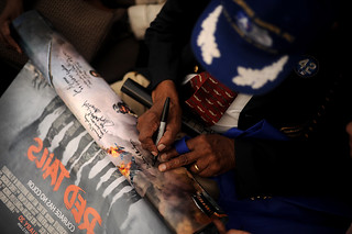 Tuskegee Airman signs Red Tails poster | by Official U.S. Air Force