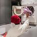 People using washing machines