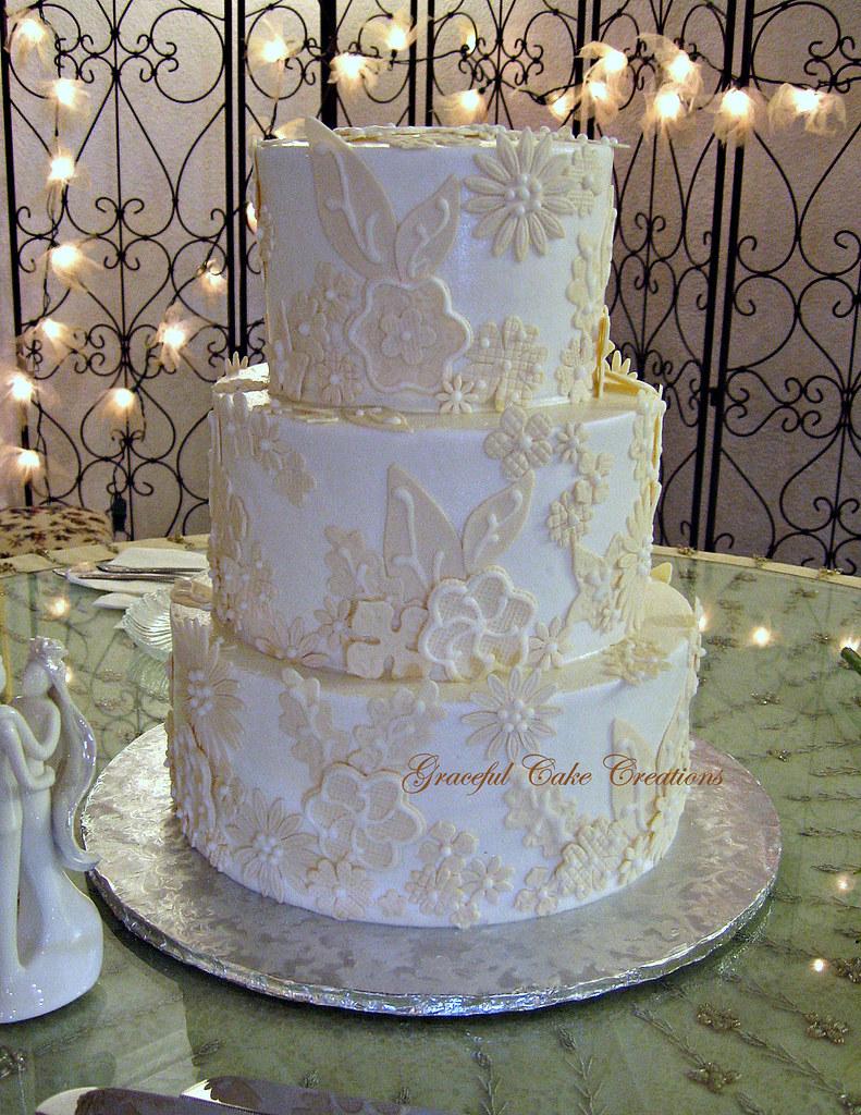 Elegant Ivory Wedding Cake with a Fondant Applique Design ...