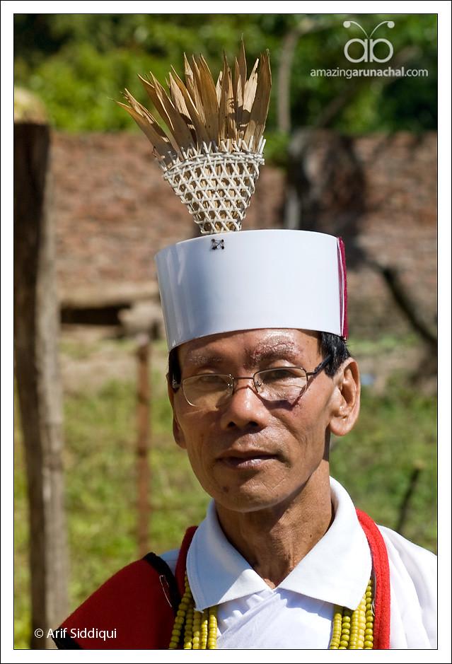 Miji man and his traditional Head gear - 8083061453_6a7e65dbab_b