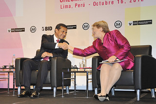 "UN Women Executive Director Michelle Bachelet greets Peruvian President Ollanta Humala Tasso at the event ""Power: Women as Drivers of Growth and Social Inclusion,"" in Lima, Peru 