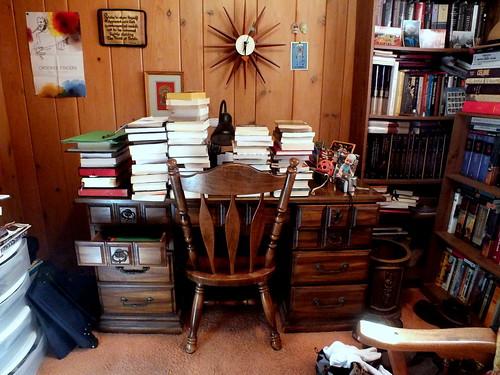 piles of books on my study desk