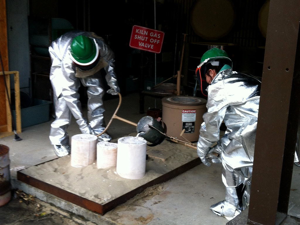 Casting a Cat Head   Two people casting with molten aluminum…   Flickr