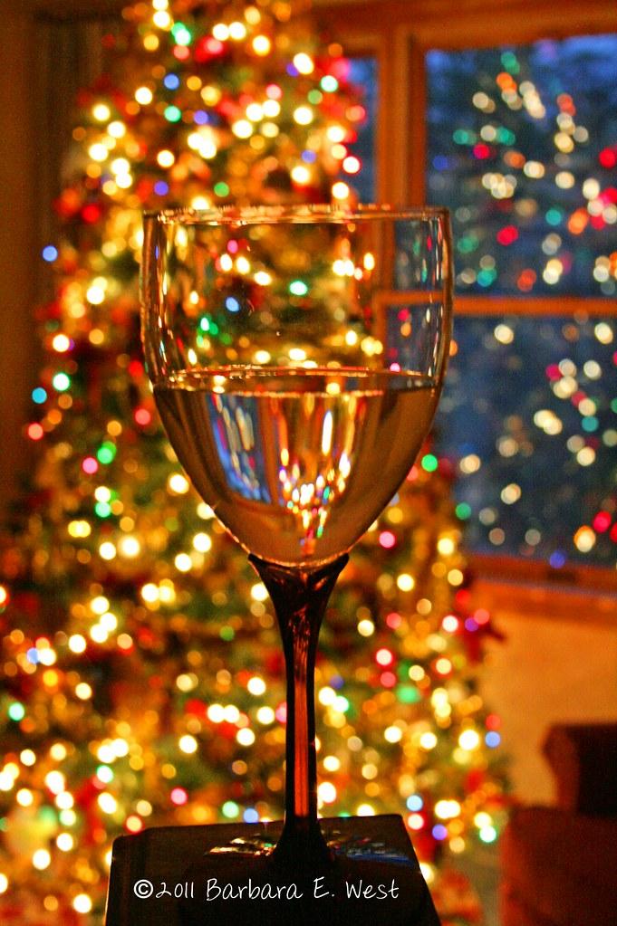 Christmas tree lights and wine glass