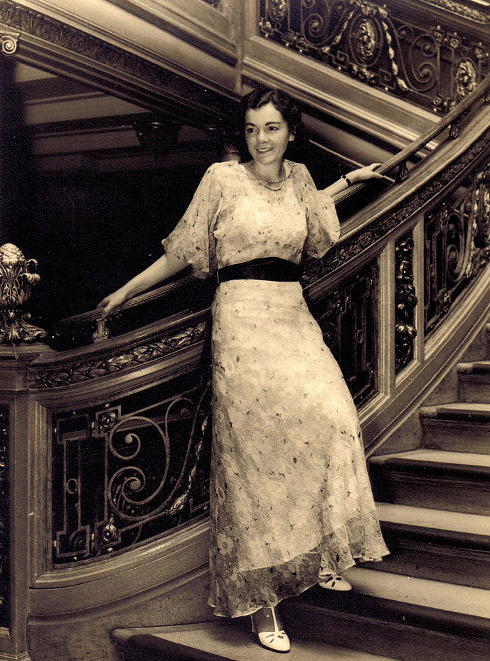 lady on grand staircase of rms olympic twin of titanic