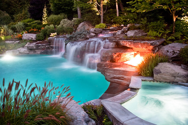 Stunning backyard luxury swimming pool with boulder for Luxury pools with waterfalls