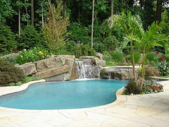 Tropical Backyard Swimming Pool And Spa Waterfall Design Ideas