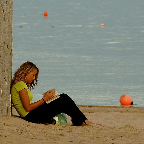 Girl reading at the beach | by pedrosimoes7