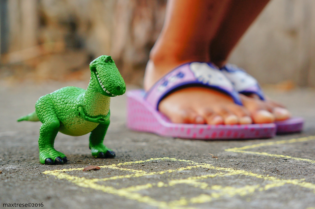 Rex the Dinosaur of Toy Story playing hopscotch