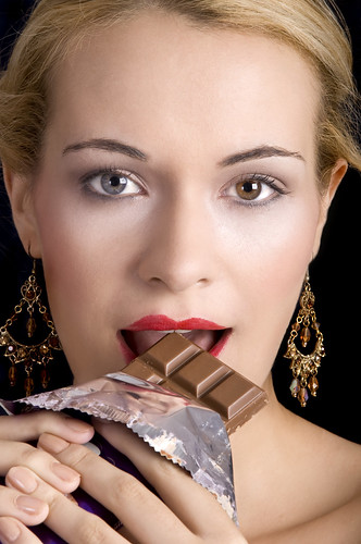 Beautiful Eat In Kitchens: Beautiful Woman Eating Chocolate
