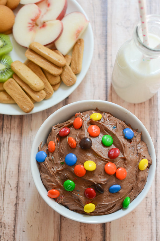 M&Ms Brownie Batter Dip - rich and delicious dessert dip! It starts with boxed brownie mix so it's quick and easy. Dip fresh fruit or graham crackers!