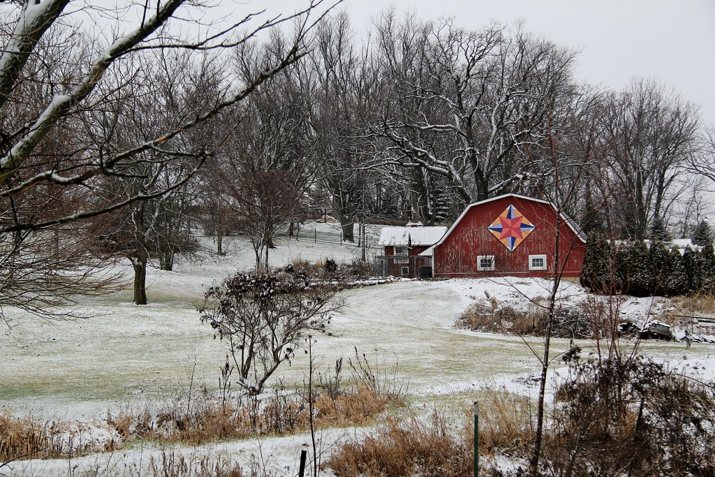 Red Barn With Barn Quilt In Snow Scene A Light Coating