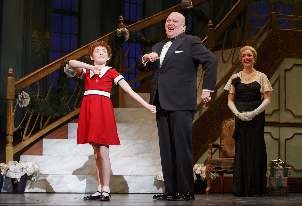 Annie and Papa Warbucks. (Credit: BASE Entertainment)
