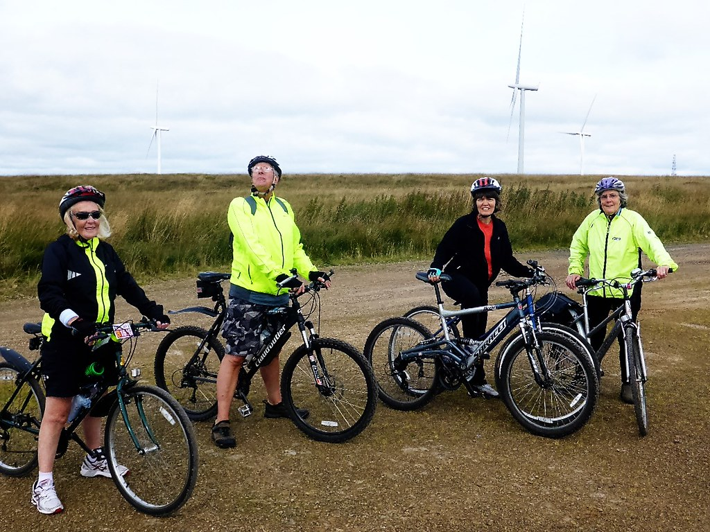 Cycling group at Whitelee Windfarm, Scotland.