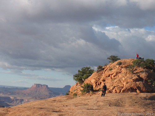 Climbing Whale Rock in Canyonlands National Park, Utah, under dubious skies