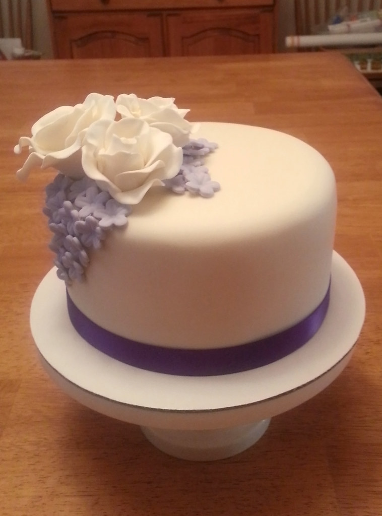 White rose and purple flower wedding cake mindy bortz flickr white rose and purple flower wedding cake by cutie cakes wy mightylinksfo