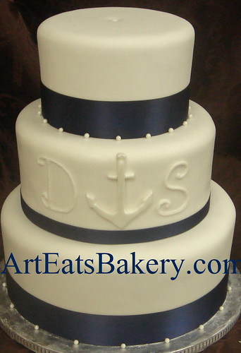 Three Tier White Fondant Wedding Cake With Navy Blue Ribbo