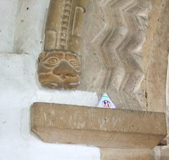 big nosed man on the chancel arch