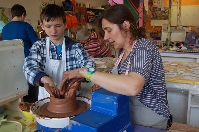 kid's pottery on the wheel