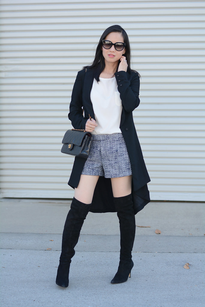 black long asymmetric blazer, tweed shorts, over the knee otk boots