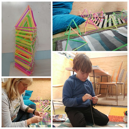 We constructed 64 tetrahedrons out of straws and string.