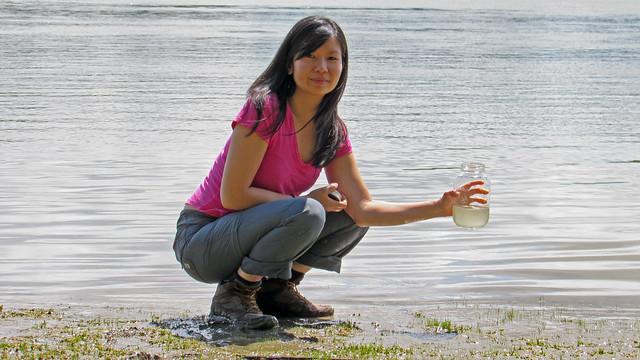 Emma Lui sampling the Fraser River