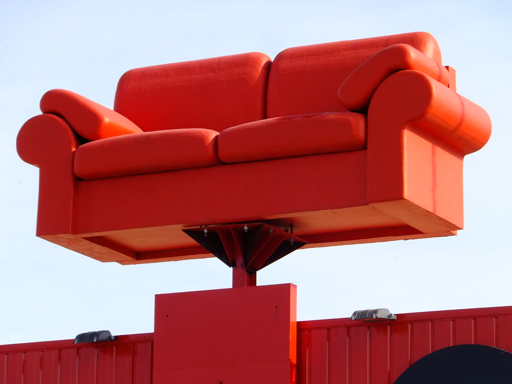 big red sofa this is the roof top mascot of world of sofa flickr. Black Bedroom Furniture Sets. Home Design Ideas