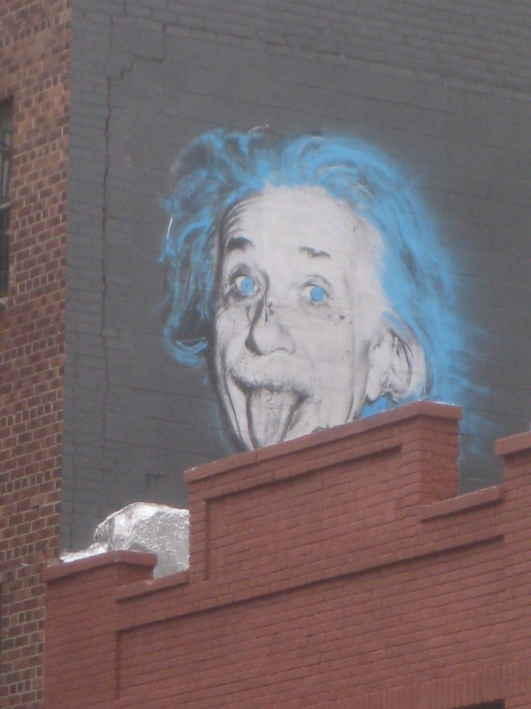 Albert Einstein with Blue Eyes and Hair Sticking Out His T ...