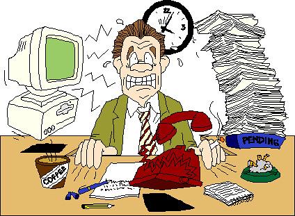 A stressed man sitting on a desk
