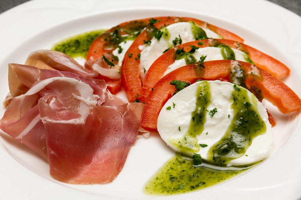 beef tomato mozzarella parma ham salad drizzled with