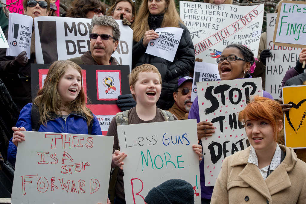 Source: Maryland GovPics on Flickr. Description: children and adults hold protest signs at the Rally to Prevent Gun Violence in Annapolis, MD.