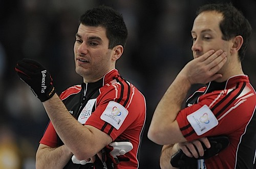 Edmonton Ab.Mar6,2013.Tim Hortons Brier.Ontario lead Craig Savill,second Brent Laing.CCA/michael burns photo | by seasonofchampions